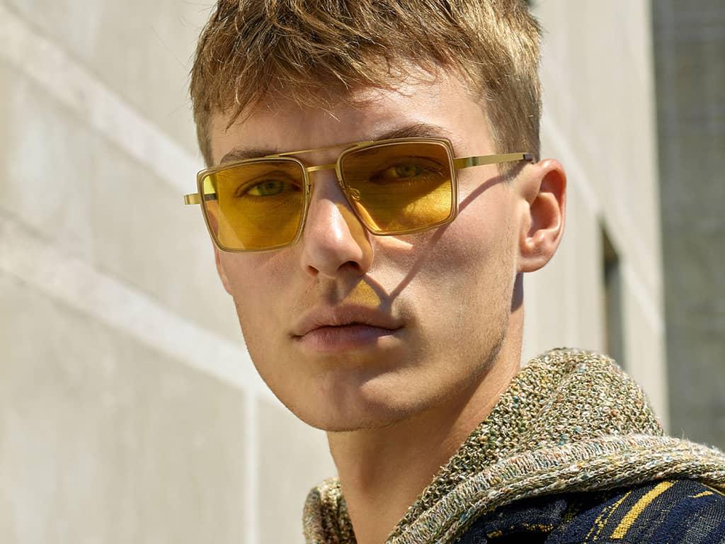 male model in hoddie wearing sunglasses
